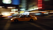 Speeding Taxi Framed Prints - Speeding Taxi NYC Framed Print by David Cook