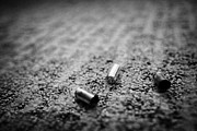 Flooring Prints - Spent 9mm Handgun Bullet Casings Lying On A Hotel Carpet Floor In The Us Print by Joe Fox