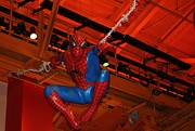 Spiderman Swinging Through The Air Print by John Telfer