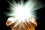 Simon Bratt Photography LRPS - Spiritual light in cupped hands on a black background