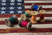 Folk Art American Flag Photos - Spools of thread on folk art flag by Garry Gay