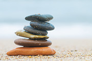 Buddhism Acrylic Prints - Stack of beach stones on sand Acrylic Print by Michal Bednarek