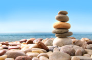 Wellbeing Prints - Stack of pebble stones on white Print by Sandra Cunningham
