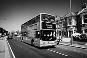 Stagecoach Posters - stagecoach red double deck bus in london suburbs London England UK Poster by Joe Fox