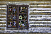 Cabin Window Photos - Stained Glass Figurines Hanging in a Window by Lynn Palmer