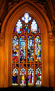 Beige Glass Framed Prints - Stained-Glass Window in the Gothic Revival Chapel. Streets of Dublin. Gothic Collection Framed Print by Jenny Rainbow