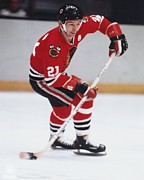 Hockey Photos - Stan Mikita shooting the puck by Sanely Great