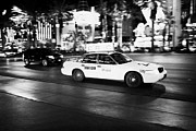 Speeding Taxi Framed Prints - star cab speeding down Las Vegas boulevard at night Nevada USA deliberate motion blur Framed Print by Joe Fox