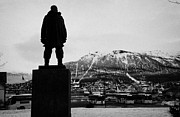 Overcast Day Posters - statue of adventurer roald amundsen looks out over Tromso harbour and  floya mountain troms Norway e Poster by Joe Fox