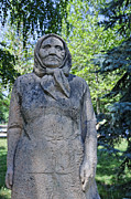 Kyrgyzstan Photos - Statue of an old woman in Dubovy Park in Bishkek Kyrgyzstan by Robert Preston