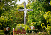 The Wooden Cross Photo Prints - Statue of Jesus on cross in wooded garden Print by Steve Heap