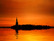 Manhattan Landscape Framed Prints - Statue of Liberty at Sunset Framed Print by John Farnan