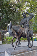 Fool Photos - Statue of the wise fool Hoja Nasruddin at Bukhara in Uzbekistan by Robert Preston