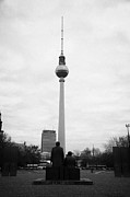 Berlin Germany Photo Prints - statues of Marx and Engels in the Marx Engels Forum looking at the berliner fernsehturm Berlin TV tower symbol of east berlin Germany Print by Joe Fox