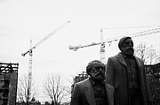 Berlin Germany Prints - statues of marx and engels with deconstruction of the palast der republik in the background Berlin Germany Print by Joe Fox