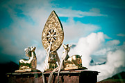 Sculpture Ideas Prints - Stautes Of Deer and Golden Dharma Wheel Print by Raimond Klavins