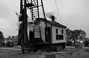 Wood Pylons Photos - Steam Pile-driver at Work BW by Larry Jones