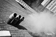 Sask Prints - steam venting from plastic exhaust pipes on old brick building downtown Saskatoon Saskatchewan Canad Print by Joe Fox