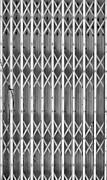 Metal Sheet Prints - Steel shutters mono Print by Antony McAulay