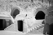 Dug Out Framed Prints - steps from the courtyard up to the entrance of the caves at the Sidi Driss Hotel underground at Matmata Tunisia scene of Star Wars films Framed Print by Joe Fox