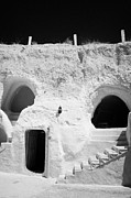 Dug Out Framed Prints - steps from the courtyard up to the entrance of the caves at the Sidi Driss Hotel underground at Matmata Tunisia scene of Star Wars films vertical Framed Print by Joe Fox
