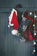 Sandra Cunningham - Stockings hanging on hooks for the holidays