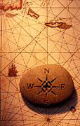 Orientation Prints - Stone compass on old map Print by Garry Gay