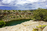Verde Valley Posters - Storm Clouds over Montezuma Well Poster by Carol Groenen