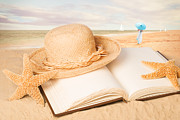 Sun Hat Framed Prints - Straw Hat On Beach With Book Framed Print by Christopher and Amanda Elwell