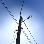 Poles Photos - Street lamp and power lines by Bernard Jaubert