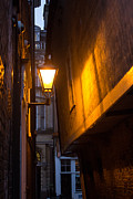 Leaning Building Prints - Street Lamp Print by Dawn OConnor