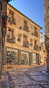 Brick Building Prints - Street of Swords Print by Joan Carroll