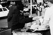Break Fast Photos - Street Vendor Selling And Handing Over Hot Dogs New York City by Joe Fox
