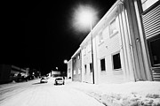 Streetlamp Posters - Streetlamp In Snow Covered Street At Night Vardo Finnmark Norway Europe Poster by Joe Fox
