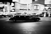 Limo Posters - stretch limo speeding down Las Vegas boulevard at night Nevada USA deliberate motion blur Poster by Joe Fox