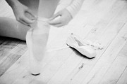 Tying Shoe Posters - Student Putting On Pointe Shoes At A Ballet School In The Uk Poster by Joe Fox
