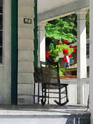 Rocking Chairs Framed Prints - Suburbs - Porch With Rocking Chair and Geraniums Framed Print by Susan Savad