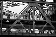 Harlem River Posters - subway train crossing the Broadway Bridge from Manhattan to the Bronx over the Spuyten Duyvil Creek Poster by Joe Fox