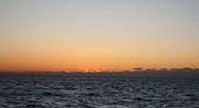Sun Rising Above Clouds And Horizon Print by John Telfer