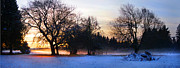 Harold Greer Art - Sun setting on snow with fog on the ground behind by Harold Greer