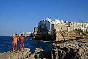Against A Wall Framed Prints - Sunbathing at Polignano a Mare Framed Print by Gianmarco Cicuzza