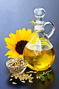 Decanter Framed Prints - Sunflower oil bottle Framed Print by Elena Elisseeva