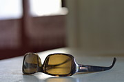Sami Sarkis Framed Prints - Sunglasses on table Framed Print by Sami Sarkis
