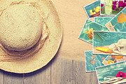Tropical Photographs Photo Framed Prints - Sunhat And Postcards Framed Print by Christopher and Amanda Elwell