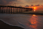 Surf Silhouette Posters - Sunrise over a fishing pier in North Carolina Poster by Stephen Goodwin