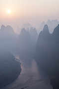 Lichen Photo Posters - Sunrise over the karst peaks - China Poster by Matteo Colombo