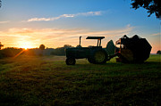 Bailing Hay Framed Prints - Sunrise Tractor Framed Print by Scott Hansen