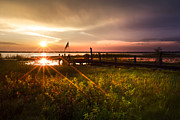 Piers Prints - Sunset Lights Print by Debra and Dave Vanderlaan