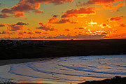 Sunset Seascape Prints - Sunset over the Gannel in Cornwall Print by Louise Heusinkveld