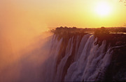 Zambia Waterfall Metal Prints - Sunset over The Victoria Falls Metal Print by Alex Cassels
